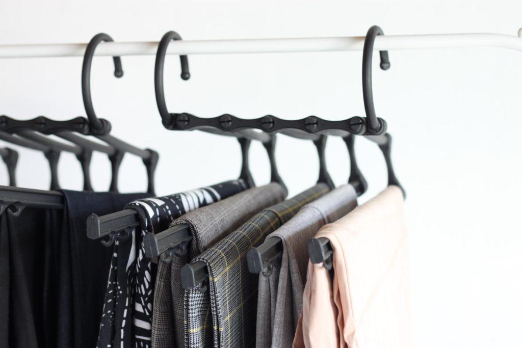 Closet organization tip 3: Use space-saving pant hangers to maximize storage - 7 small closet organization tips