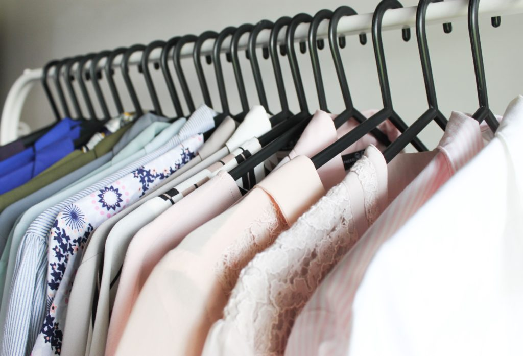Closet organization tip 1: Use Plastic hangers from the dollar store for a cohesive look on a budget - 7 small closet organization tips