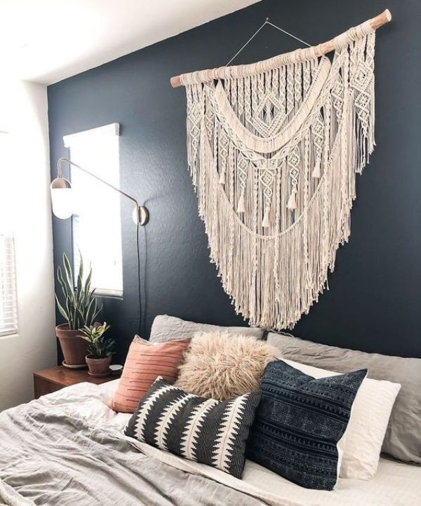 macrame wall hanging above bed as headboard