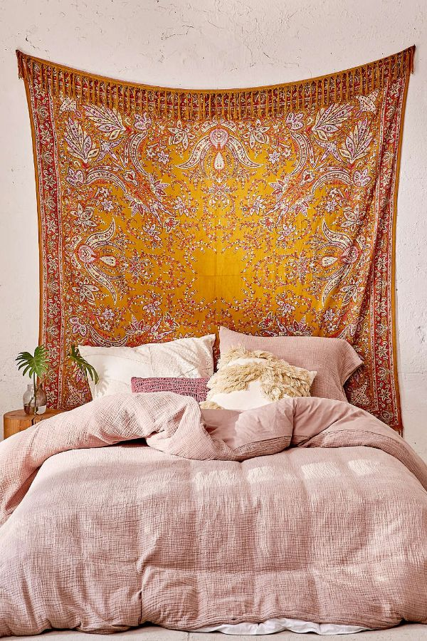tapestry as headboard in bedroom