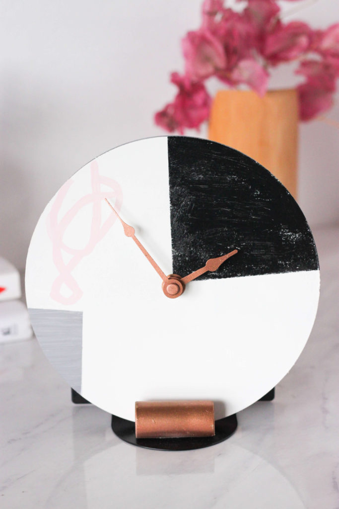 Transform a regular clock into a minimalist piece of wall decor with this easy West Elm inspired DIY Wall Clock tutorial. Get the look without the price tag! #diyhomedecor #westelmknockoff