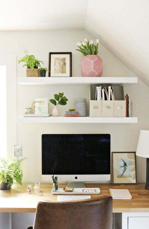 home office with styled floating shelves