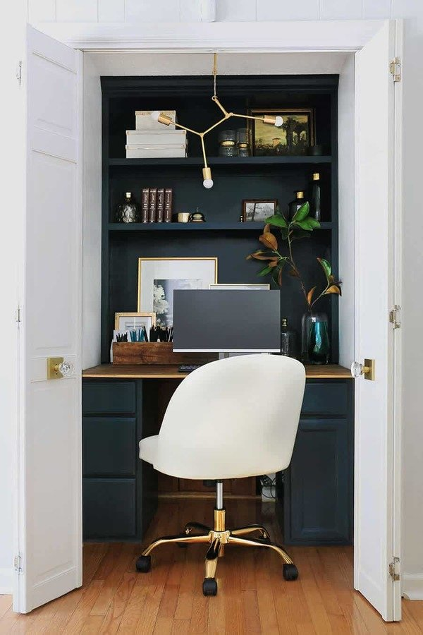 closet office with floating shelves