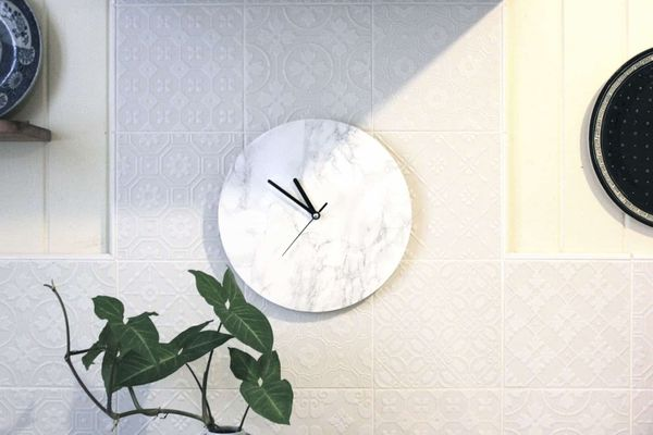 Clock with marble background