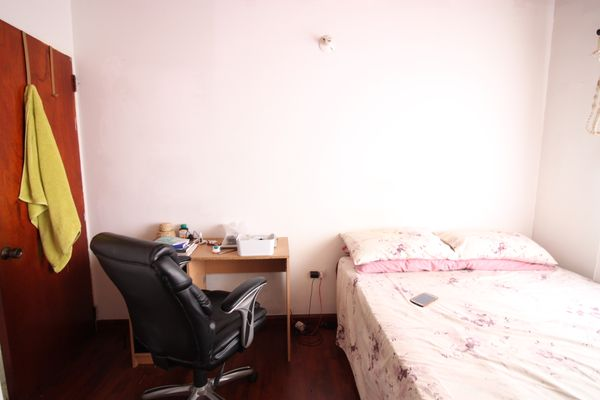 small bedroom with desk and chair