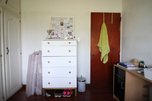 small bedroom with painted ikea dresser and desk